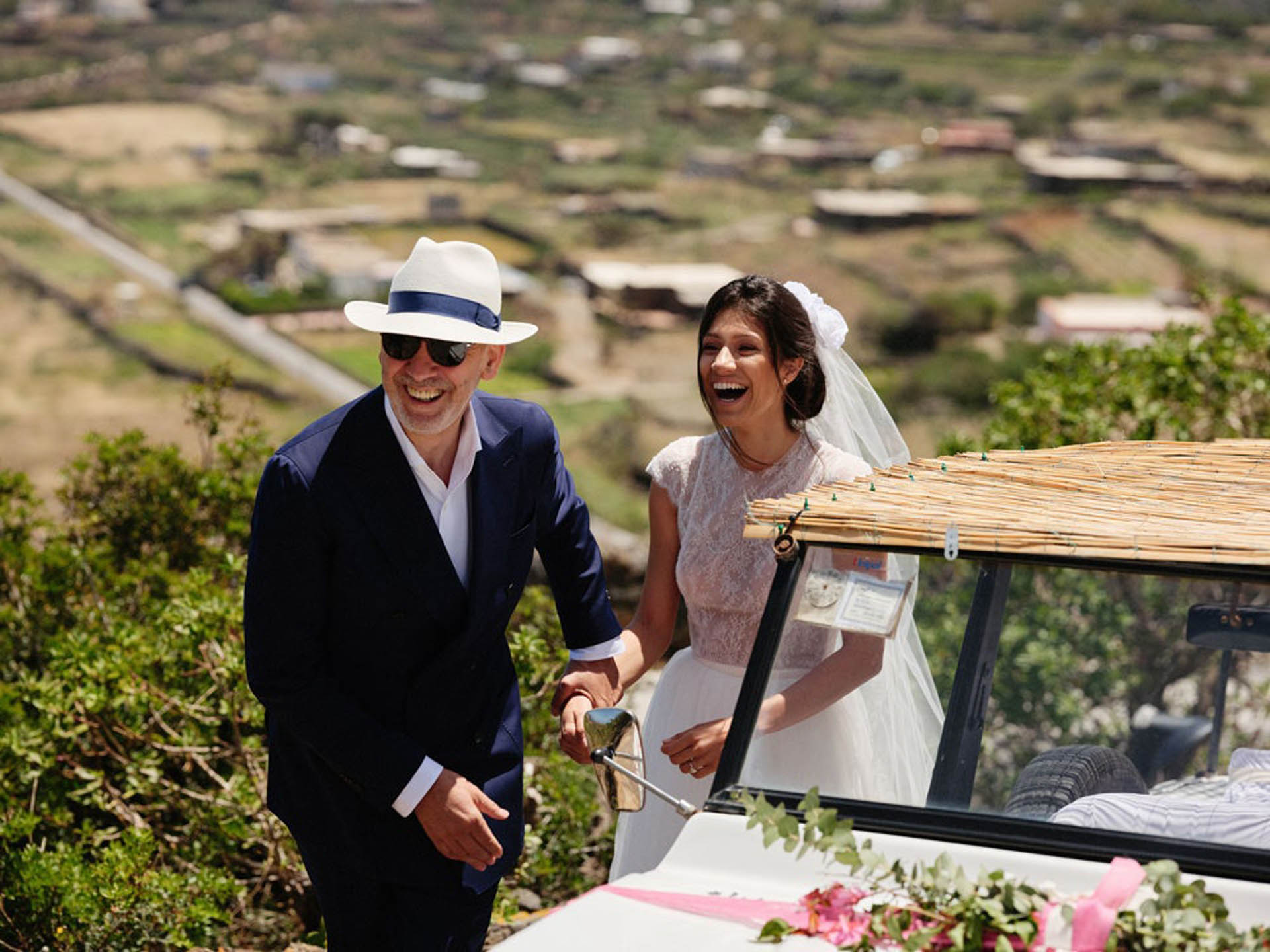 Wedding Couple and getaway car