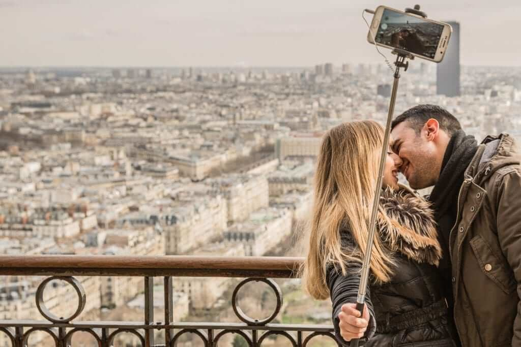 couple taking honeymoon picture for instagram