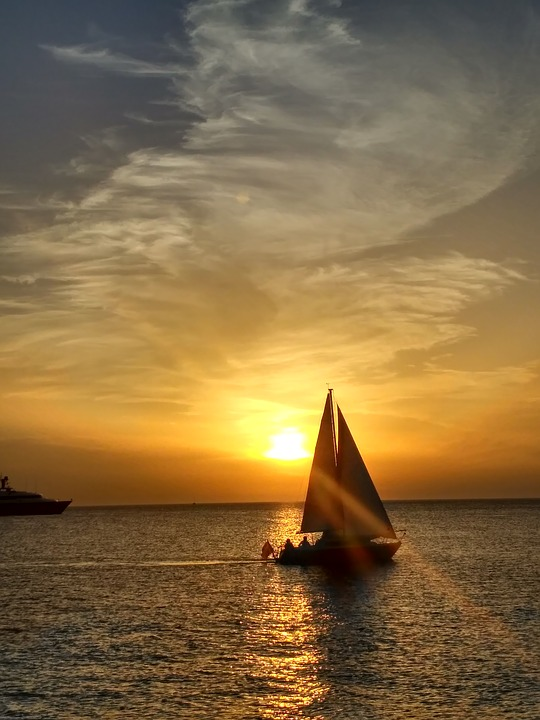 Sail at sunset through the Balearic Islands