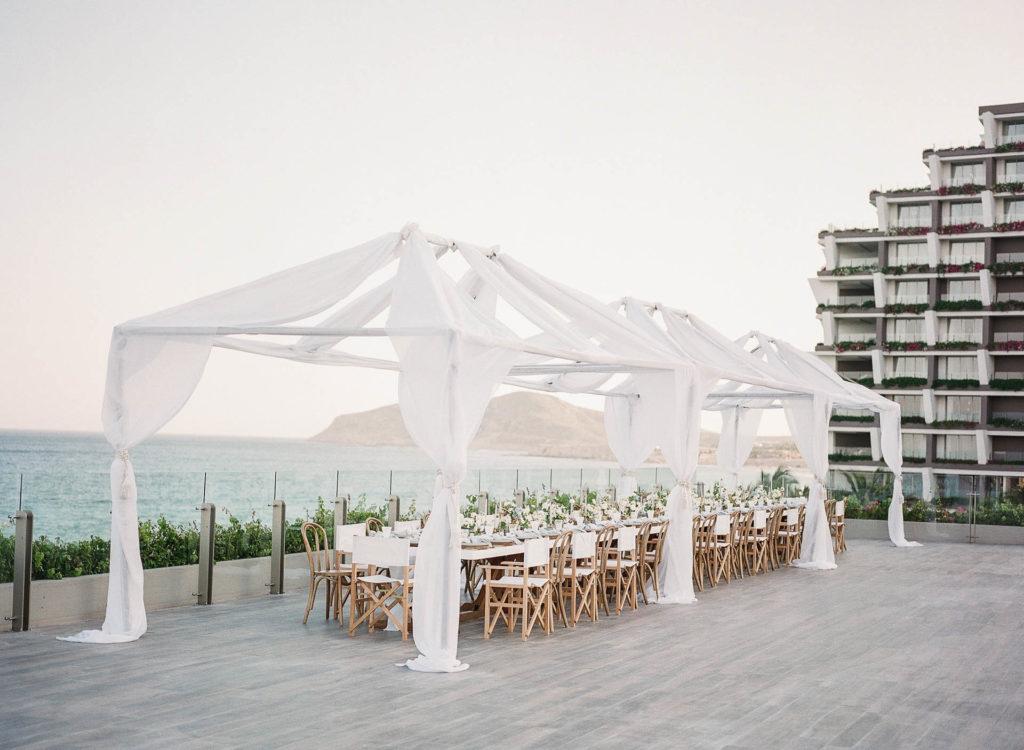 Outdoor wedding banquet at a beach resort