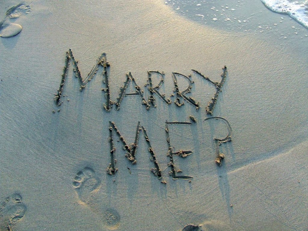 Marry Me drawn in the sand