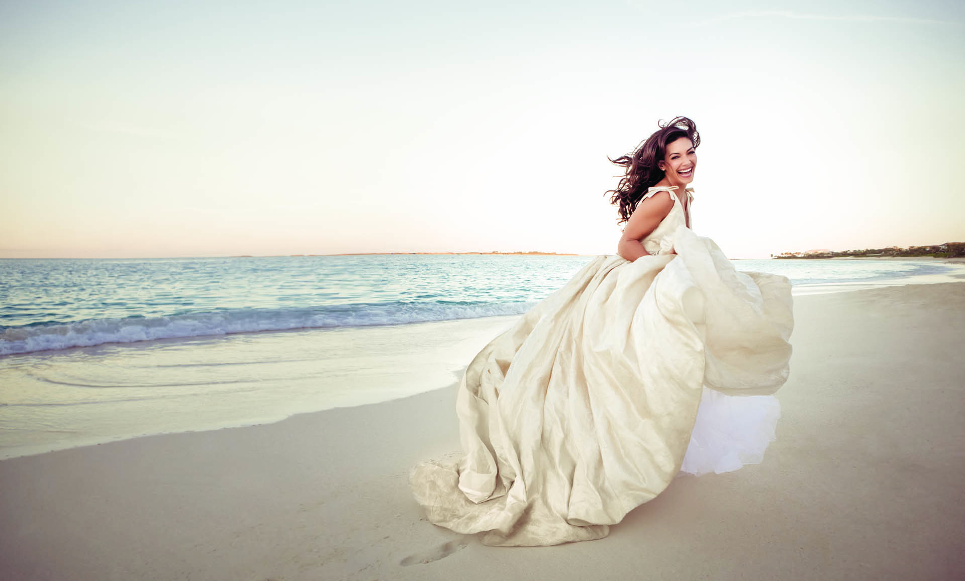 Bride running on the beach