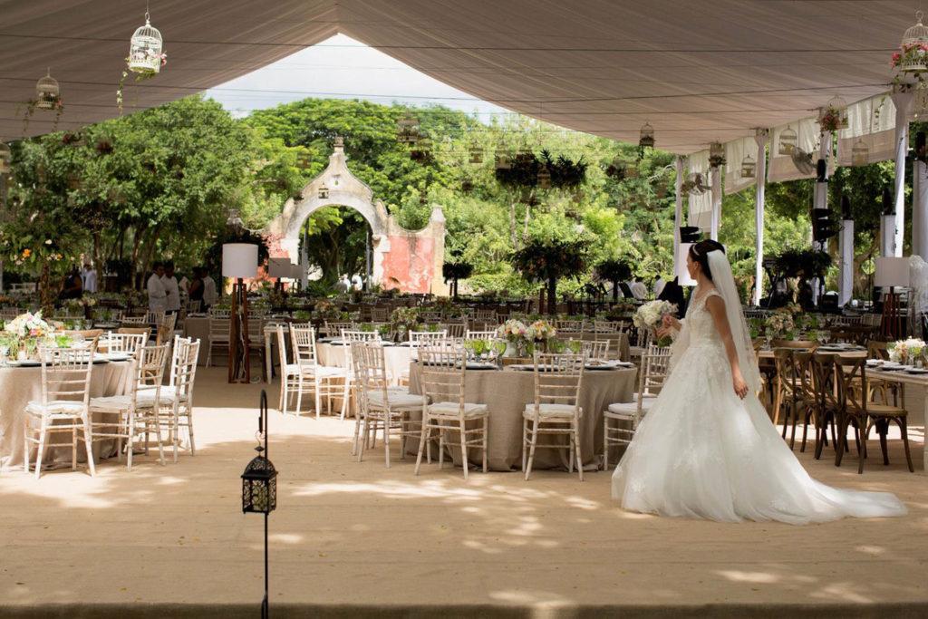 Bride walking through reception set up outdoors