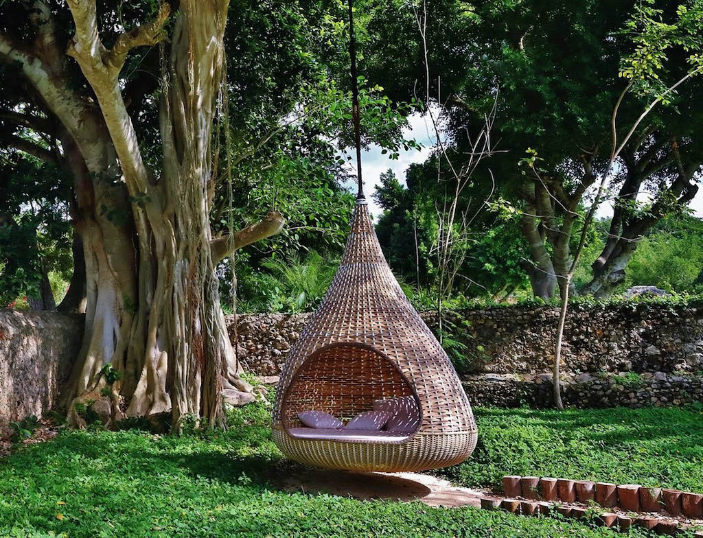 TEARDROP CHAPED CHAIR HANGING FROM TREE