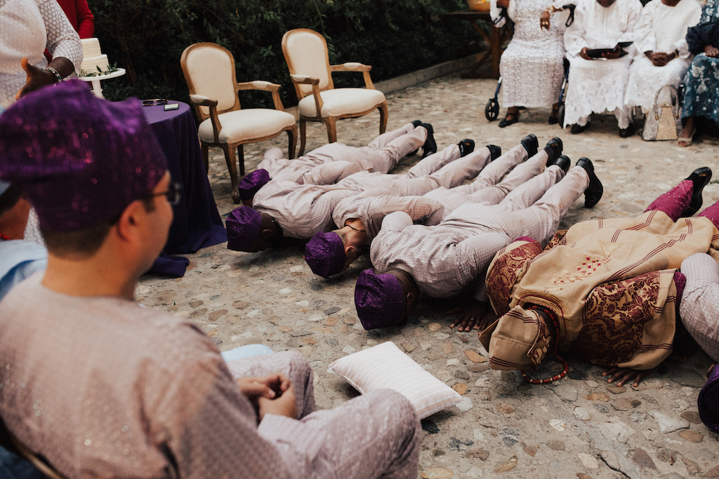 Nigerian wedding men in the wedding party prostrating themselves