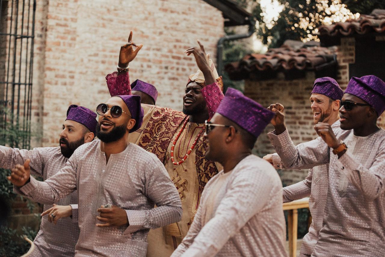 Nigerian wedding male guests dancing with groom