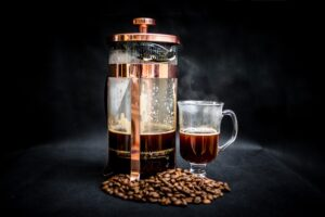 French press coffee, beans & clear cup of coffee