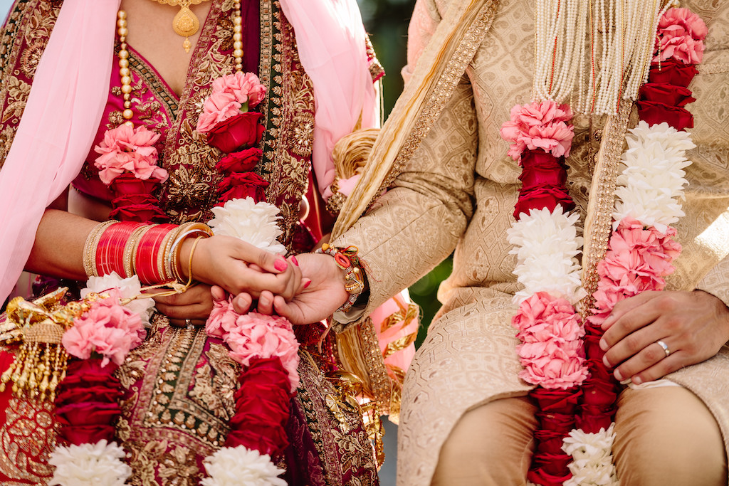Indian wedding couple holding hands