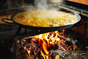 boiling paella over an open flame