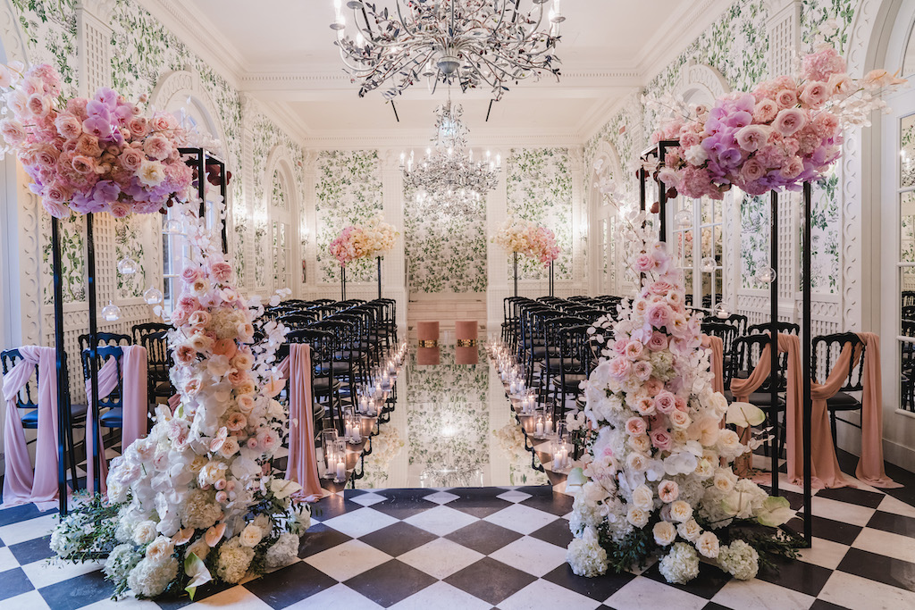 hotel wedding isle in checkered floor with pink flowers
